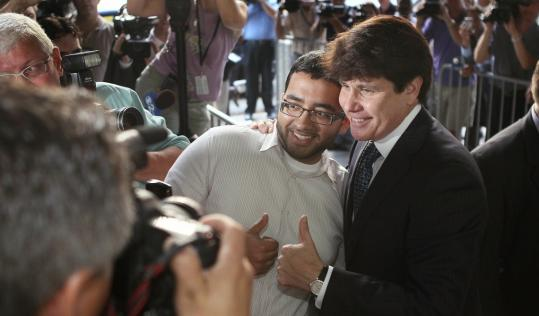Rod Blagojevich posed with a spectator as he arrived at a Chicago courthouse yesterday. He said he has learned a lot of lessons during the trial, including that he talks too much.