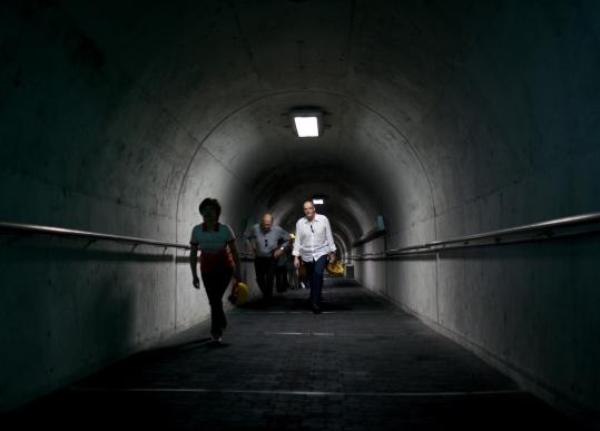 Visitors take an underground walkway to access the Third Infiltration Tunnel.
