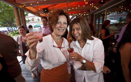 Rialto's Jody Adams (left) and Ten Tables' Krista Kranyak celebrate the opening of Rialto's outdoor terrace last night.