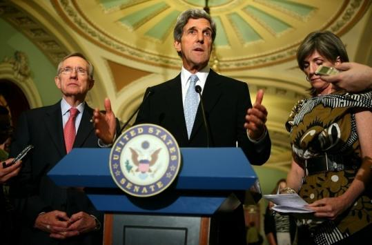 For Senator John F. Kerry, shown with Senate majority leader Harry Reid and White House energy adviser Carol Browner, the decision to shelve his climate bill is a stinging setback.