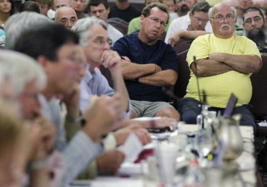 Lobstermen Joe Horvath (right) of Belmar, N.J., and Tom Viesiadecki of Point Pleasant, N.J., listened to the American Lobster Management Board. More than 70 concerned lobstermen were at yesterday's meeting.