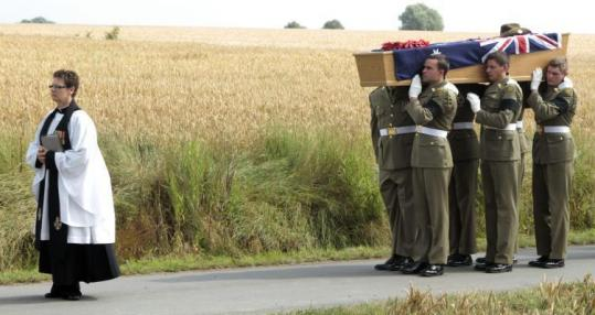 The Australian Federation Guard carried the coffin of Private Alan James Mather for his reburial in Ploegsteert, Belgium.