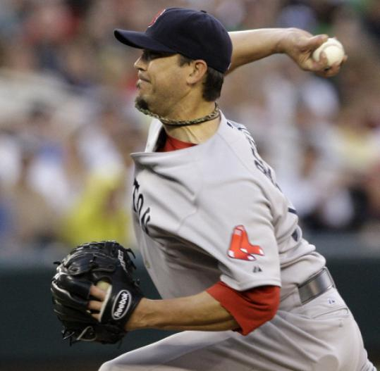Josh Beckett looked like his old self, allowing just one run in 5 2/3 innings.