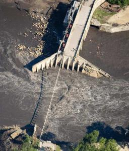 An aerial view of the Lake Delhi dam in eastern Iowa taken yesterday. The dam failed on Saturday, causing major flooding.