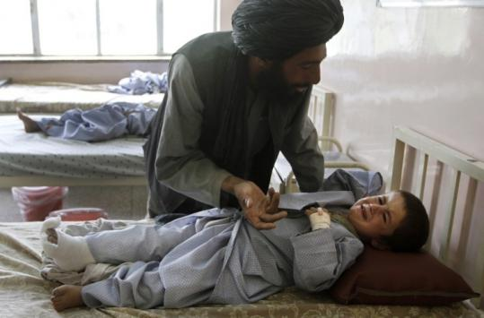 Abdul Ghafaar comforted his nephew at a hospital in Kandahar, Afghanistan, Saturday after a firefight in Sangin.