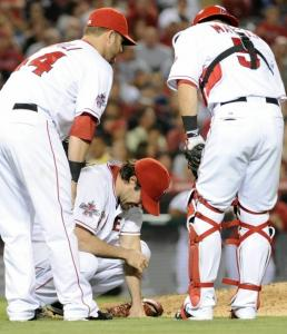 Dan Haren is forced from the game five innings into his Angels debut after being hit on the right arm by a Kevin Youkilis liner. He was diagnosed with a bruised forearm.