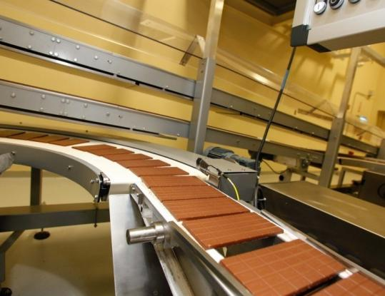 Lindt, which now roasts and grinds its beans in Stratham, N.H., can produce 450 chocolate bars and 7,200 truffles per minute