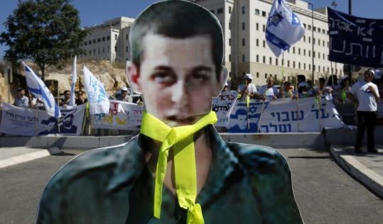 Protesters in Israel last month used a cutout photo of Gilad Shalit in calling for the release of the soldier captured by Palestinian militants in 2006.