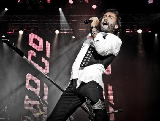 At the helm of Bad Company, the powerful voice of Paul Rodgers roused an exultant crowd last night at the Bank of America Pavilion.