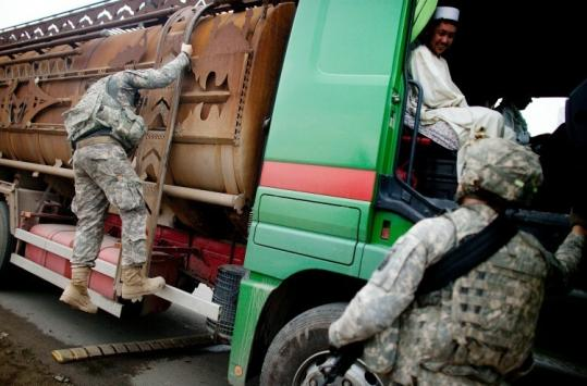 In Afghanistan, US Marines yesterday stopped a truck at a checkpoint to search for a missing Navy sailor.