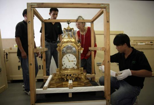Nancy Berliner, Peabody Essex Museum Chinese art curator, watched workers pack a clock yesterday in Beijing.