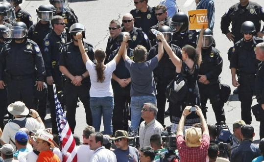 Phoenix police arrested people protesting the immigration law at the Maricopa County sheriff's office yesterday.