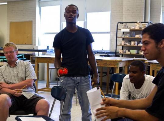 "Led by instructor Tory Bullock (standing), summer school students participated in a spoken word poetry exercise at Boston Arts Academy. ""It was very, very difficult to get kids to really participate in the beginning,'' Bullock said, though some did open up."