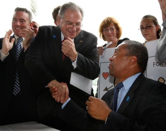 House Speaker Robert A. DeLeo and Governor Deval Patrick had a collegial interlude at a bill-signing ceremony yesterday.