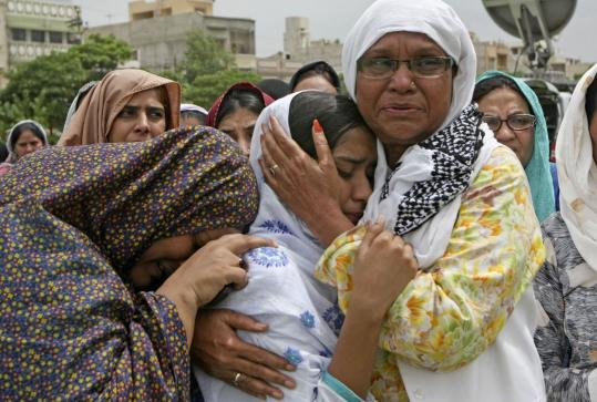 Fareed Khan/Associated Press Family members of Raza Haider, slain leader of the Muttahida Quami Movement, cried during his funeral in Karachi yesterday