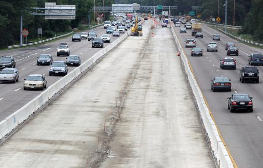 The Route 128 widening project is making progress, as seen from a bridge over the highway near the Houghton&#8217;s Pond exit in Milton.
