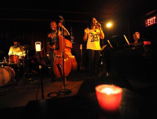 The Olatuja Project: Michael Olatuja on acoustic bass, his wife, singer Alicia Olatuja, Oli Rockberger on piano, and John Davis on drums.