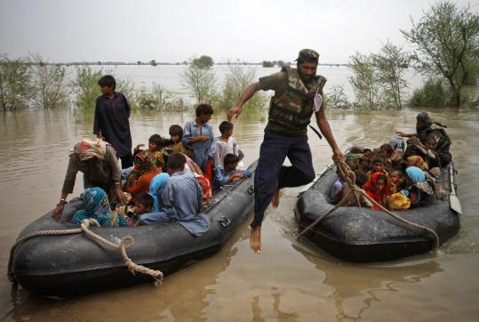 Pakistan navy personnel rescued stranded villagers from flooded area at Toree Band, in the Kashmir district near Sukkar in the Sindh Province. Floods triggered by monsoon rains have killed about 1,500 people; millions more have been affected.