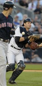 Mike Lowell was issued a free pass when Yankees catcher Francisco Cervelli dropped his popup in the Red Sox' three-run second inning.