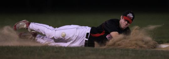Reading Bulldog Doug Dellorfon of Natick dives for a grounder Monday against the Blue Sox.