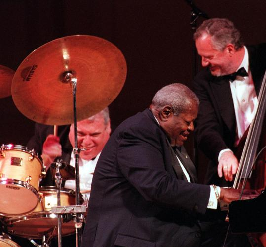 Martin Drew, Oscar Peterson, and Niels-Henning Orsted Pederson performing at Carnegie Hall.
