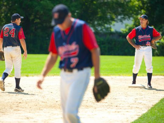 The Flutie boys: Doug (right), Bill (center), and Darren (left) man the infield for the Natick Knights in the Mass. Senior Baseball League.