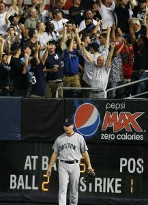 J.D. Drew walks away as Yankees fans celebrate a homer by Mark Teixeira.