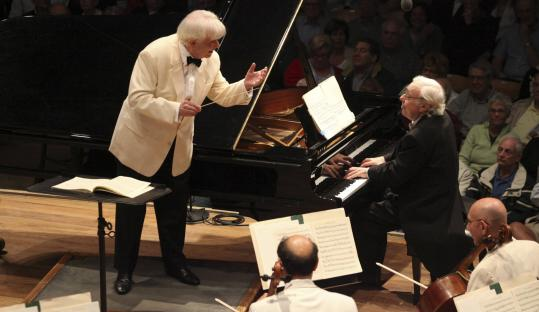 Christoph von Dohnanyi performing with the BSO in Mozart's Piano Concerto No. 14 with pianist Richard Goode on Friday.