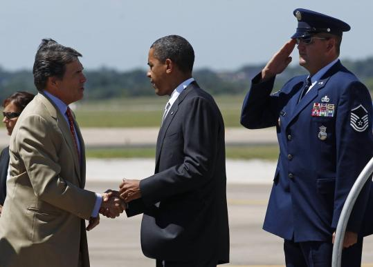 Governor Rick Perry (left) greeted President Obama at Austin Bergstrom International Airport in Austin, Texas.