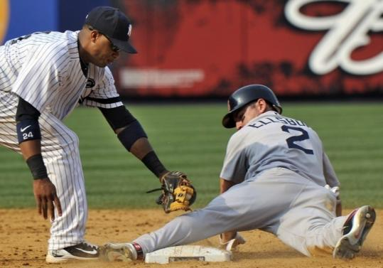 Jacoby Ellsbury slides into second ahead of Robinson Cano's tag in the ninth. It was Ellsbury's fourth theft of the game.