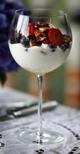 Berries top a yogurt parfait, the final touch to a meal begun with a caprese salad.
