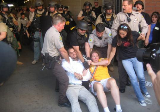 Police took the Rev. Wendy von Zirpolo of Gloucester to jail during a protest on the new immigration law in Phoenix.
