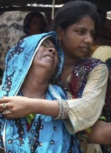 Family members comforted a woman who had lost her house to heavy flooding in Sukkar, Pakistan.