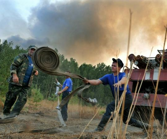 Hundreds of wildfires, including this one near the village of Tokhushevo, have created a sense of desperation in some parts of Russia.