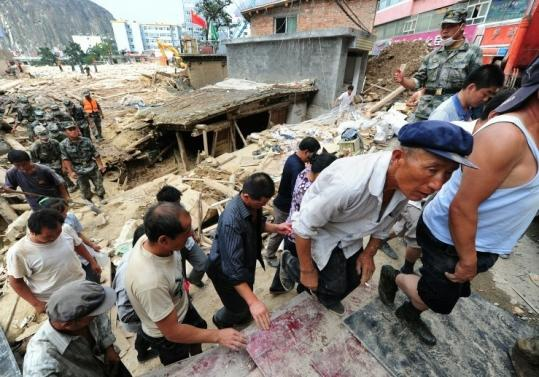 The military evacuated residents yesterday amid the rubble of Zhouqu, China. At least 45,000 people have been evacuated.