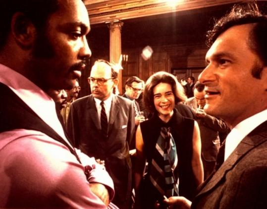 The documentary seeks to recast the publisher in a flattering pioneer's glow. Right, Hugh Hefner with Jesse Jackson.