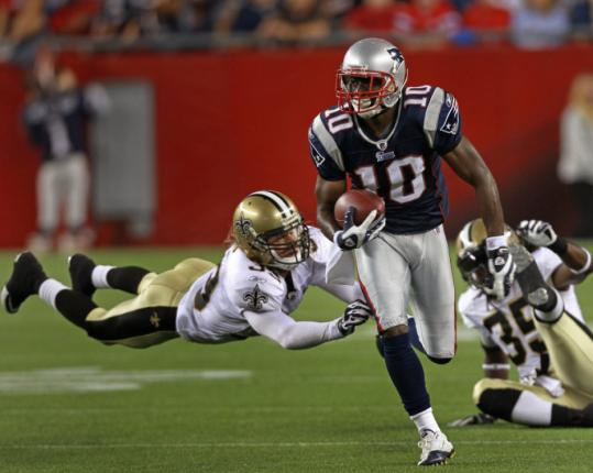 Patriots receiver Darnell Jenkins leaves a pair of defenders in his wake as he takes off on a 52-yard catch-and-run to set up the winning field goal.