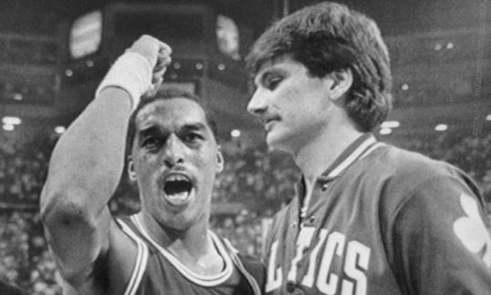Dennis Johnson (left) celebrates a victory with teammate Greg Kite during the Celtics' glory years in the 1980s.