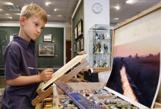 Kieron Williamson, Britain's most talked-about young artist, worked on a drawing at his home.