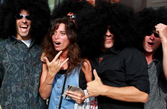 Lisa Demmons was surrounded by fans of J. Geils's harmonica player Magic Dick outside Fenway Park last night. Bill Hatfield (left), Rick Ramos (in black), and some other friends wore wigs paying homage to the musician's hairdo.
