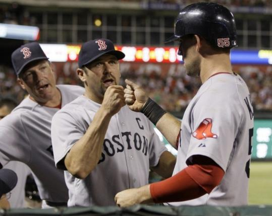 Ryan Kalish is greeted by Jason Varitek (center) and Dave Magadan after scoring in the ninth.