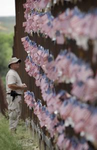 Richard Loomis Jr. of Yarmouth, Maine, viewed US flags on the Arizona border wall at yesterday's rally.