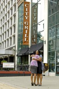 Angela Smith and Sonya Thigpen consoled each other yesterday outside City Grill in Buffalo, the scene of a shooting in which Smith's longtime friend, Tiffany Wilhite, was killed.