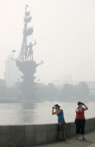 A Moscow statue of Peter the Great was shrouded in smog yesterday. The air was expected to improve today.