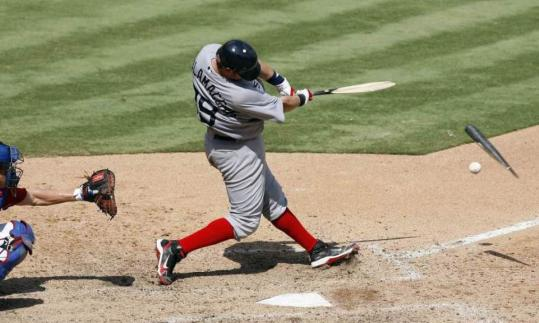 Red Sox catcher Jarrod Saltalamacchia breaks his bat as he grounds to third off Rangers pitcher C.J. Wilson in the seventh inning.