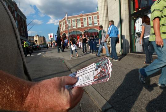 A scalper has plenty of tickets for sale to a recent game between the Red Sox and Tigers at Fenway Park.
