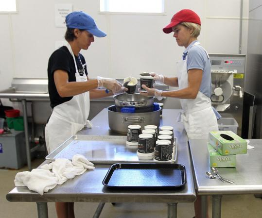 Co-owners Susie Parish (left) and Veronica Janssens pack pints of Batch ice cream.