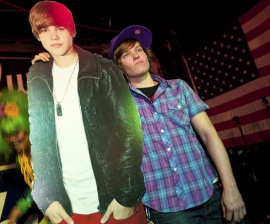 "Justin Bieber look-alike contest winner ""Drake'' poses with a cardboard cutout of the teen singer."