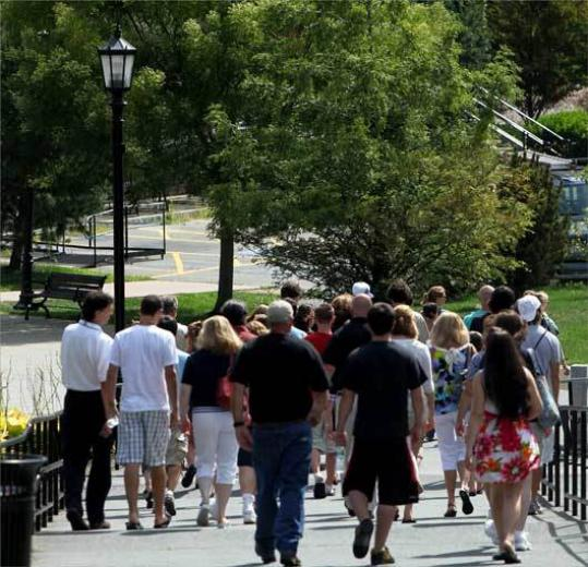 A group tours the Bridgewater State campus on a recent summer day.