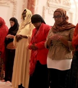 Women pray before breaking Ramadan fast at the Malcolm X and Dr. Betty Shabazz Memorial and Educational Center Tuesday in New York.